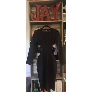 Long sleeve dress with side cut outs. HIGH QUALITY